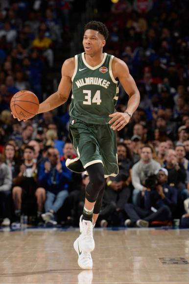 PHILADELPHIA, PA - APRIL 11: Giannis Antetokounmpo #34 of the Milwaukee Bucks handles the ball during the game against the Philadelphia 76ers on April 11, 2018 in Philadelphia, Pennsylvania NOTE TO USER: User expressly acknowledges and agrees that, by downloading and/or using this Photograph, user is consenting to the terms and conditions of the Getty Images License Agreement. Mandatory Copyright Notice: Copyright 2018 NBAE (Photo by David Dow/NBAE via Getty Images)